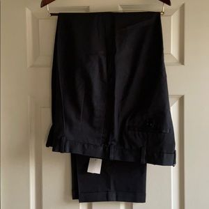 Black pants. Pleated front.